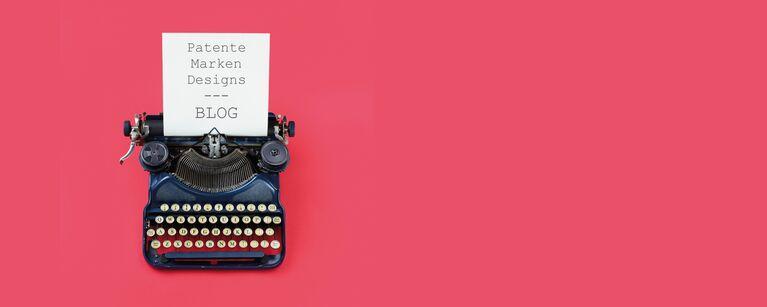 mechanische Schreibmaschine mit eingespanntem Papier, darauf steht: Patente, Marken, Designs Blog